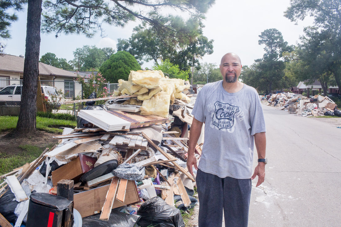 Lakewood, Houston resident standing on street in middle of damage caused by Hurricane Harvey